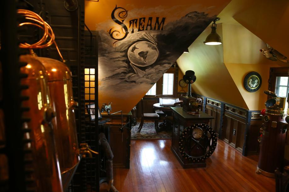 The third floor holds a steampunk-style office, cedar closet, another office, a full bath with claw-foot tub, and a good-size artist's studio.